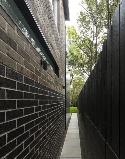 Cosgriff House side passage black bricks & highlight glazing with view to rear
